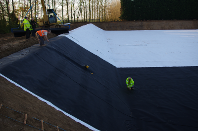 Liner being laid in sections and welded